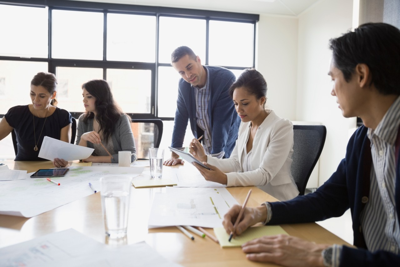 Architects working in conference room